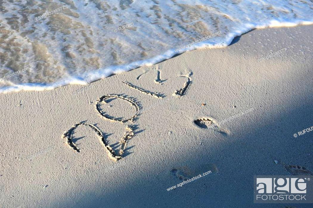 Stock Photo: New Year 2014 season is coming concept - inscription 2013 and 2014 on a beach sand.