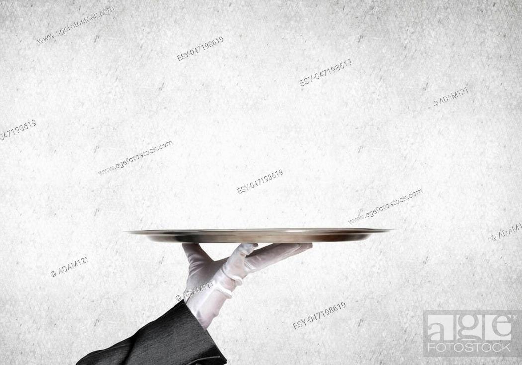 Photo de stock: Waiter hand in white glove presenting empty tray.