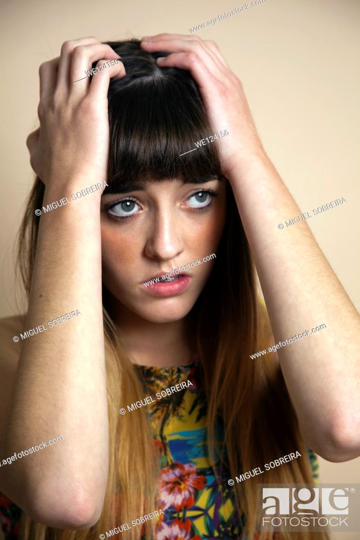 Stock Photo: Teenager Holding Head in Anxiety / Sorrow.