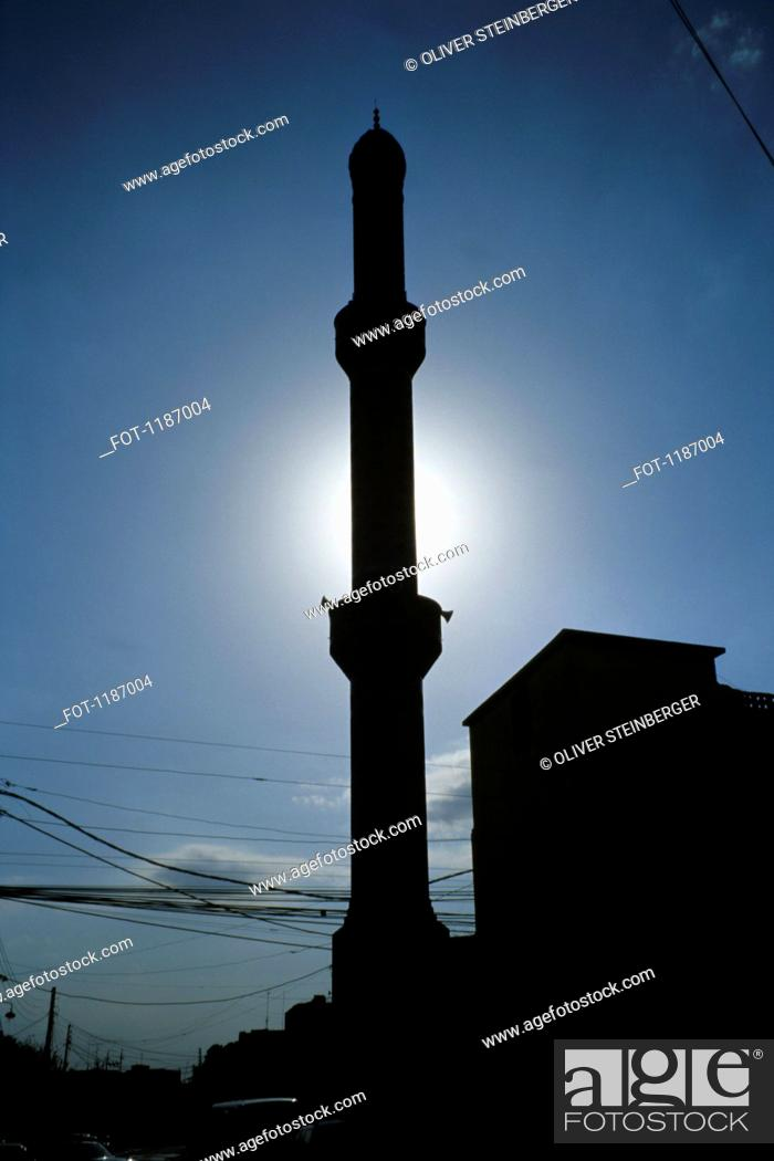 Stock Photo: Silhouette of minaret and power lines in Arbil, Iraqi Kurdistan, Iraq.