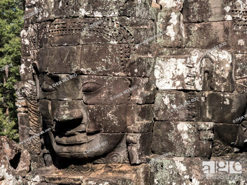 Stock Photo: Angkor Temples - stone faces of Bayon Temple towers, Angkor Thom, Cambodia, Asia.