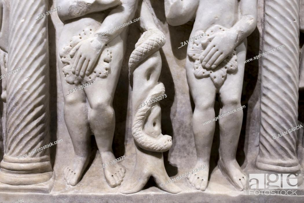 Stock Photo: Scene of Adam, Eve and the serpent on tree life. Medieval gravestone fragment.