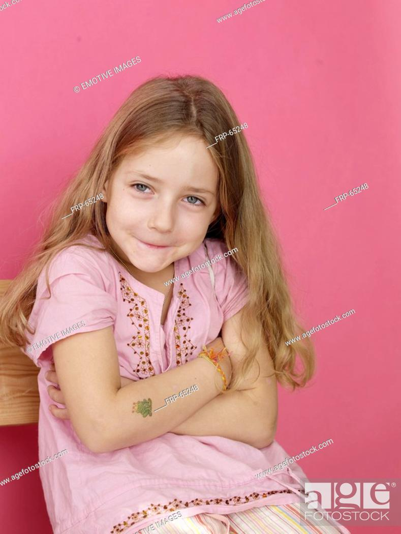 Stock Photo: Sitting blonde girl.