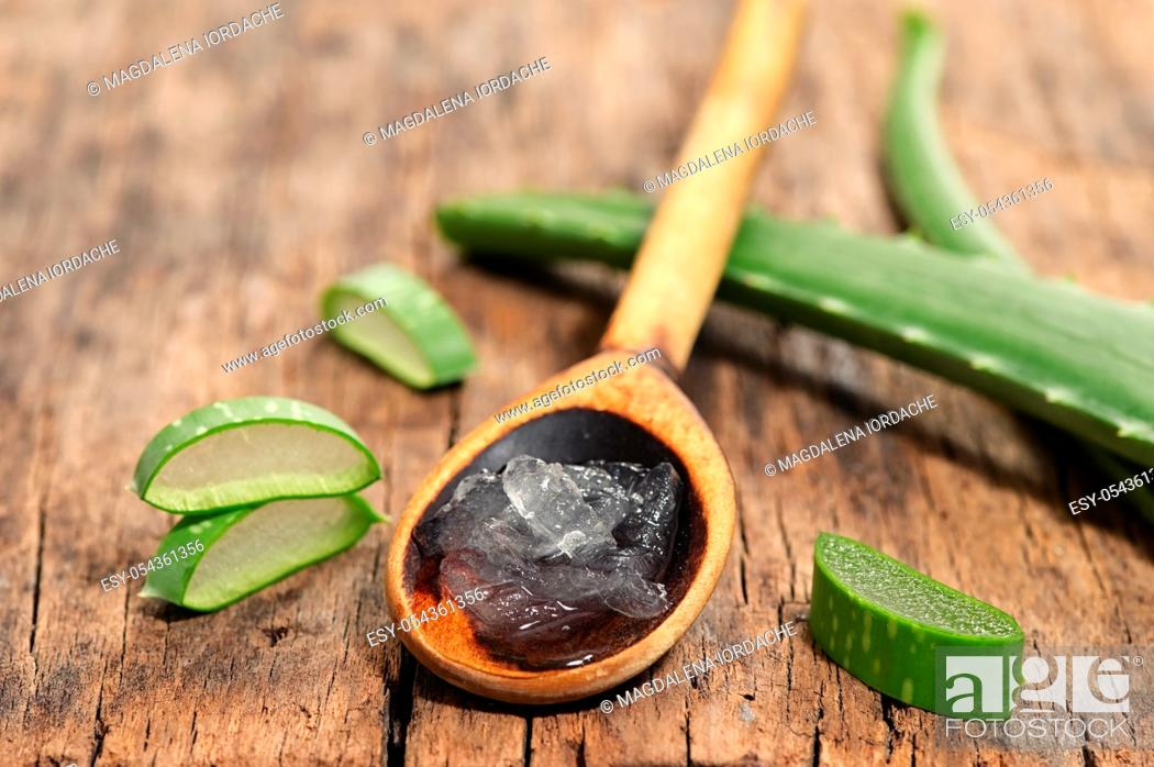 Stock Photo: Aloe Vera Slices On Wooden Table And Spoon With Aloe Gel.