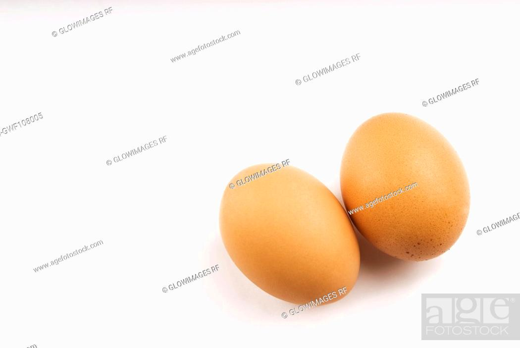 Stock Photo: High angle view of two brown eggs.