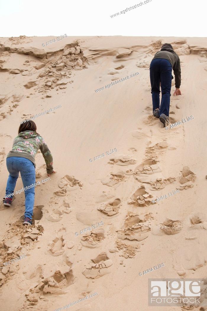Stock Photo: two children up sand dune.