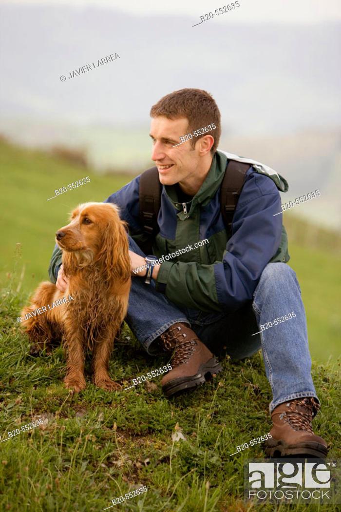 Stock Photo: Hiker and Cocker Spaniel dog.