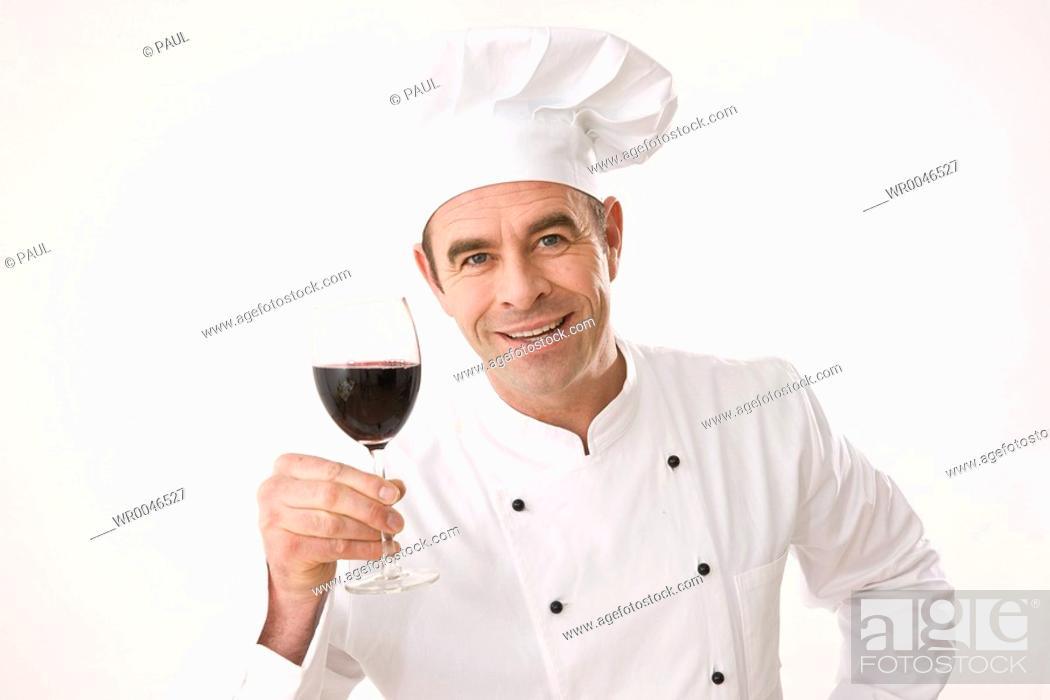 Stock Photo: Chef holding glass of red wine.