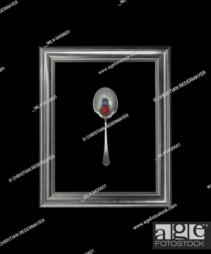 Stock Photo: Still life with a Rasberry and a Blueberry on a spoon in the frame.