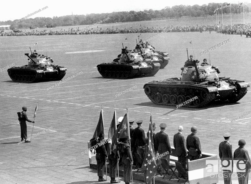 Stock Photo: American tanks passing a VIP stand during a parade on occasion of the 'Armed Forces Day' at airport Tempelhof in Berlin on 17th May 1958.