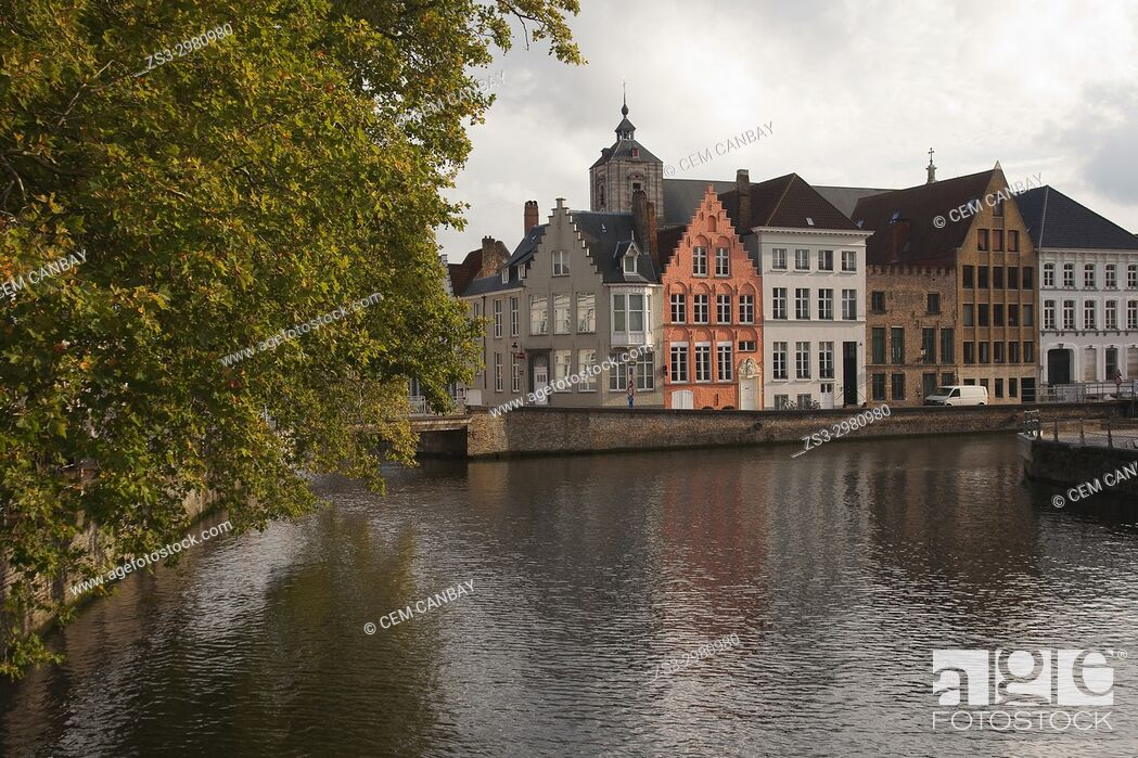 Stock Photo: View to the traditional houses by the canal in the city center, Bruges, West Flanders, Belgium, Europe.