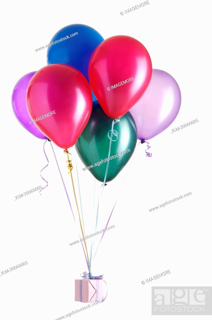 Stock Photo: Balloon tied up with a present.