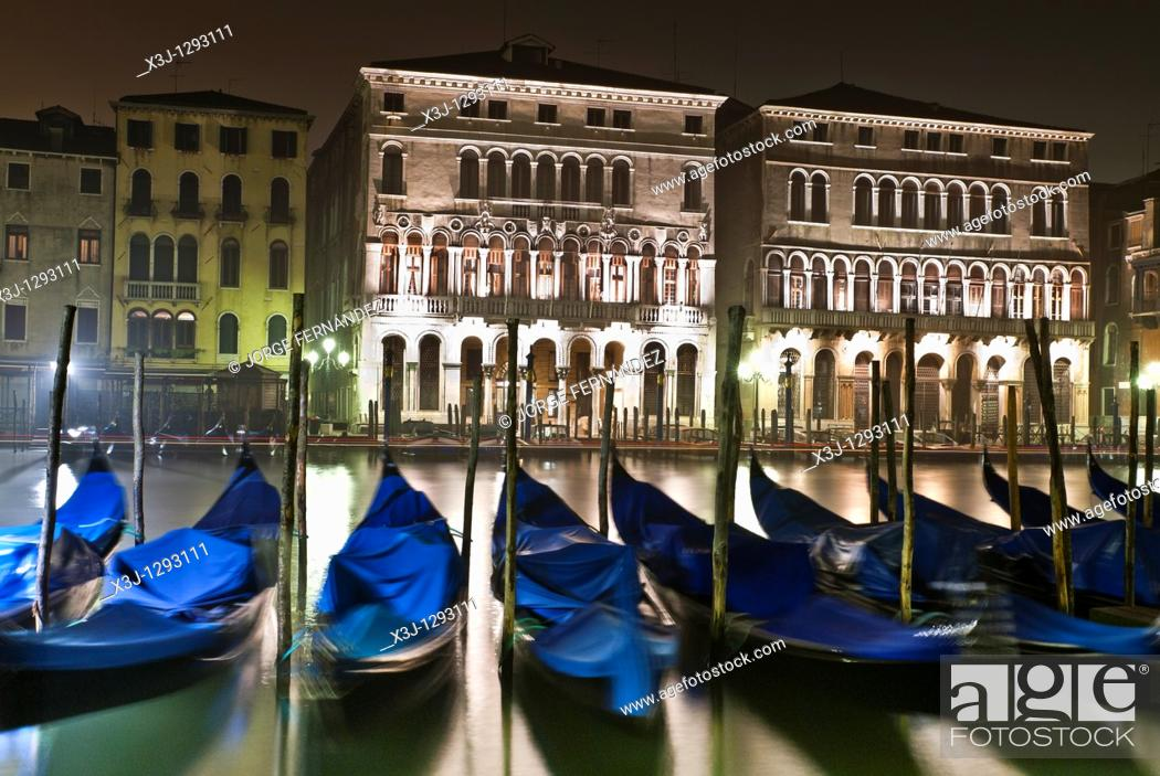 Stock Photo: View of the Grand Canal and gondolas at night, Venice, Italy.
