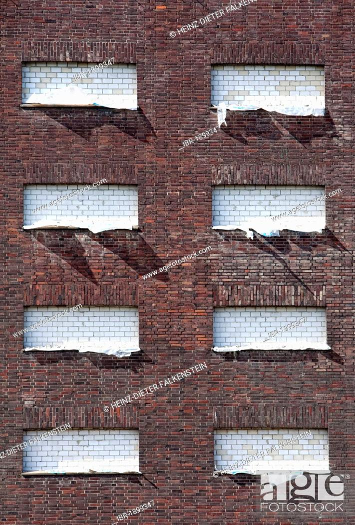 Stock Photo: Windows of a house bricked up with sand-lime bricks.