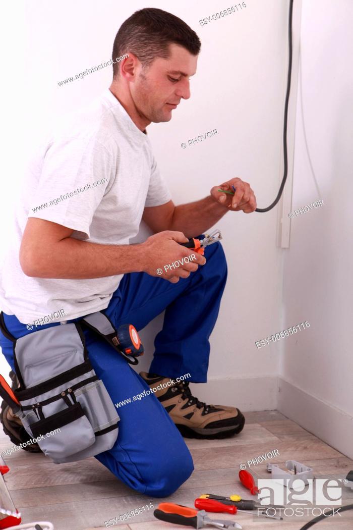 Stock Photo: Electrician preparing wiring.