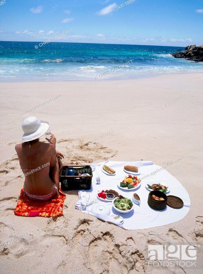 Imagen: Woman Enjoying A Picnic On The Beach.