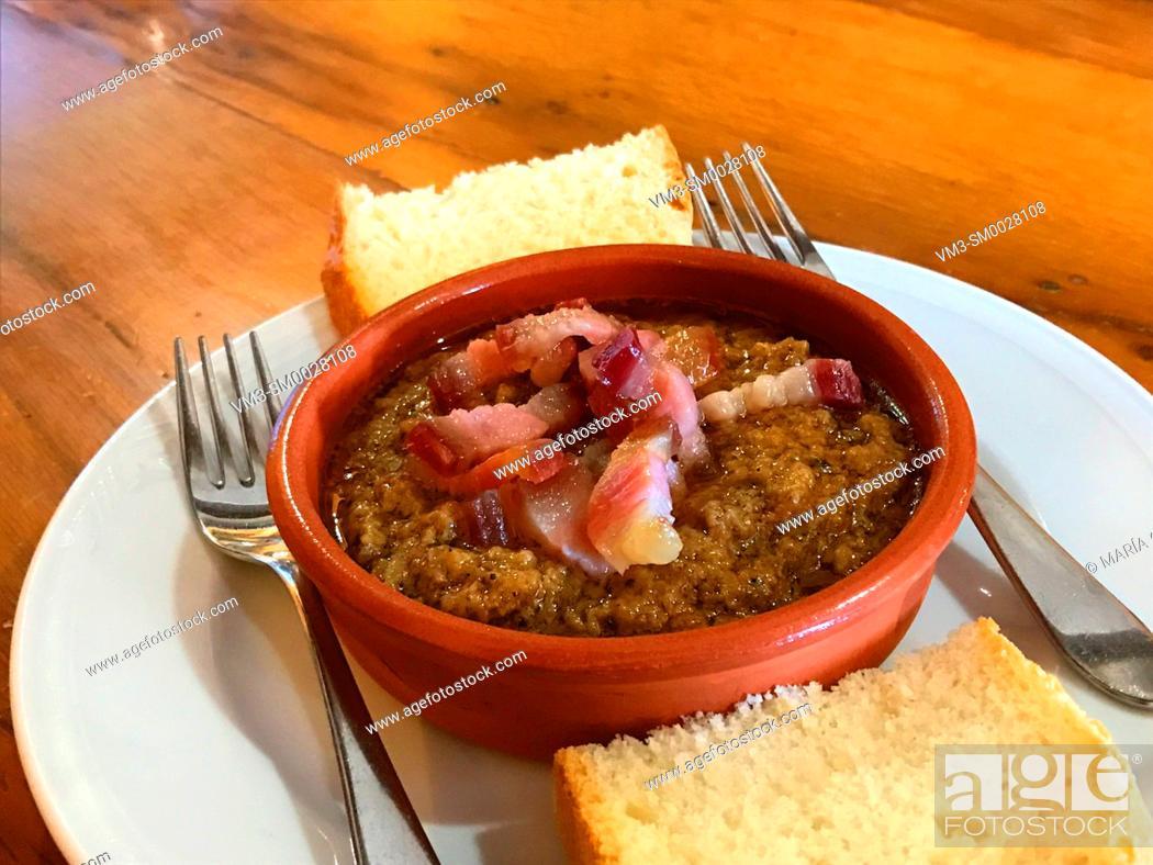 Stock Photo: Spanish tapa: Cazuela with picadillo and ham. Spain.