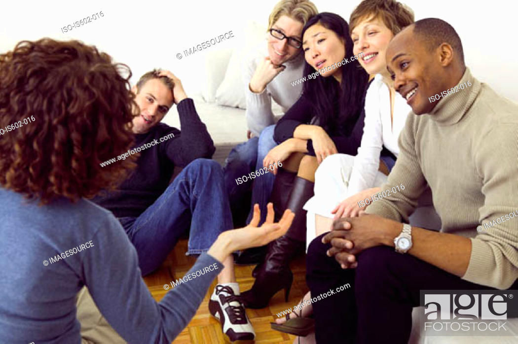 Stock Photo: Friends talking in living room.