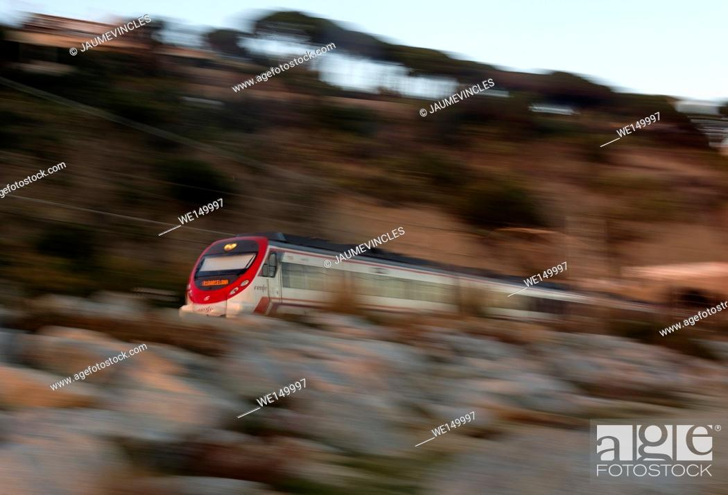 Stock Photo: Commuter train traveling from Arenys de Mar to Caldes d'Estrac, Barcelona province, Spain.