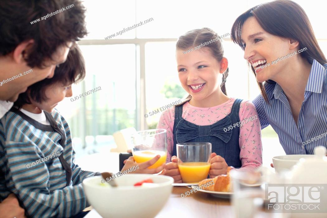 Stock Photo: Family eating breakfast together.