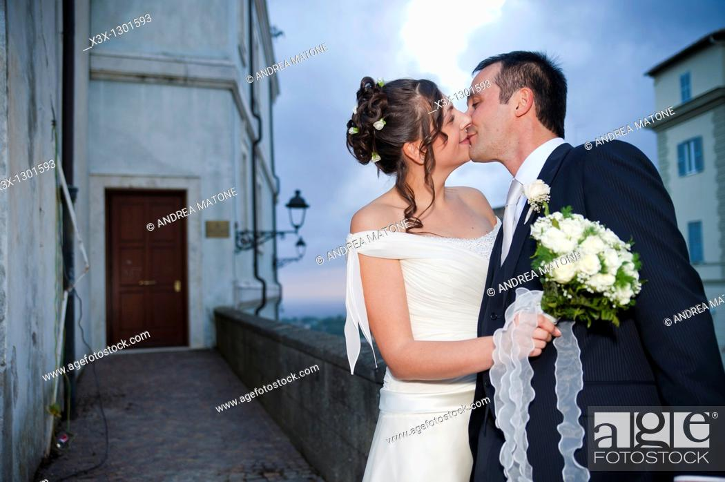 Stock Photo: Newlyweds kissing at night.