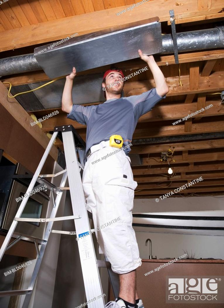 Stock Photo: Middle Eastern man remodeling house.