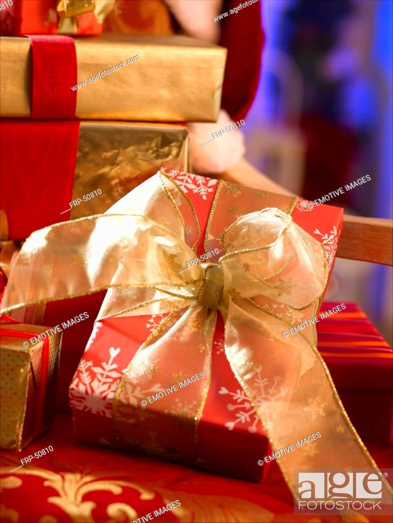 Stock Photo: Red Christmas gift with a golden ribbon.