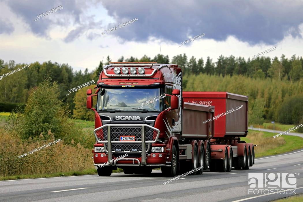 Stock Photo: Salo, Finland - September 28, 2018: Red Scania R730 truck and gravel trailer for limestone haul of R Aalto on the road in autumn in South of Finland.