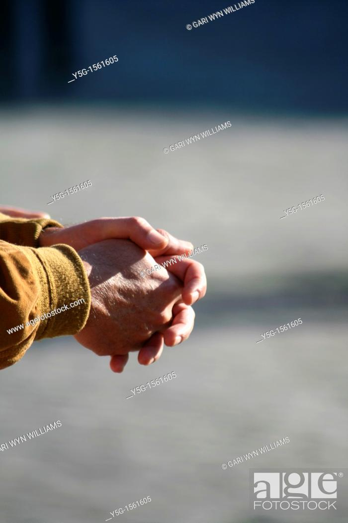 Stock Photo: close up of man's hands in town.