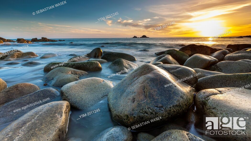 Stock Photo: Sunset over the Porth Nanven, a rocky cove near Land's End, Cornwall, England, United Kingdom, Europe.