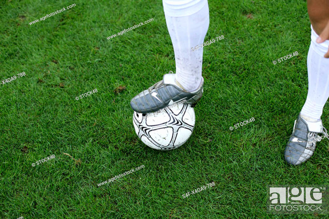 Stock Photo: Soccer player's foot on a ball.