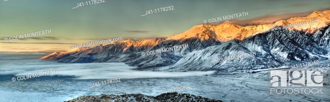 Stock Photo: Dawn on Ben Ohau Range above cloud covered Lake Pukaki from Burnett Mountains, Canterbury New Zealand.