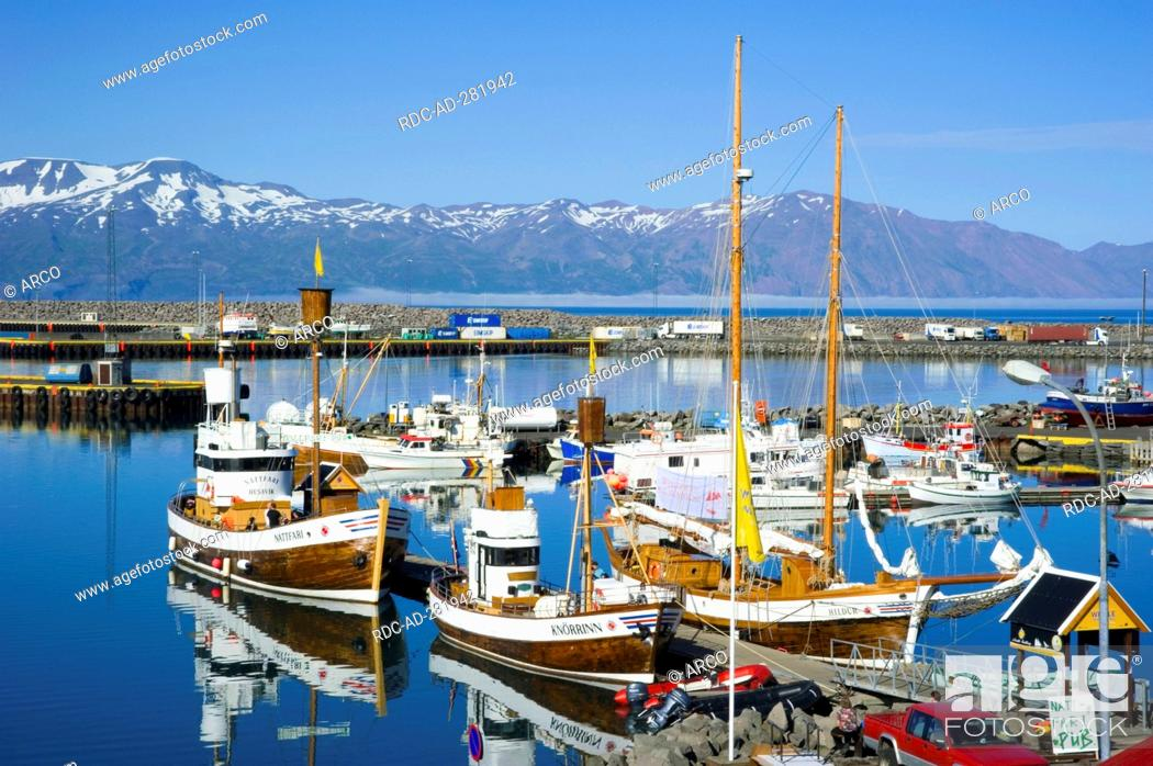 Stock Photo: Whale watching boats, harbour, Husavik, Iceland.