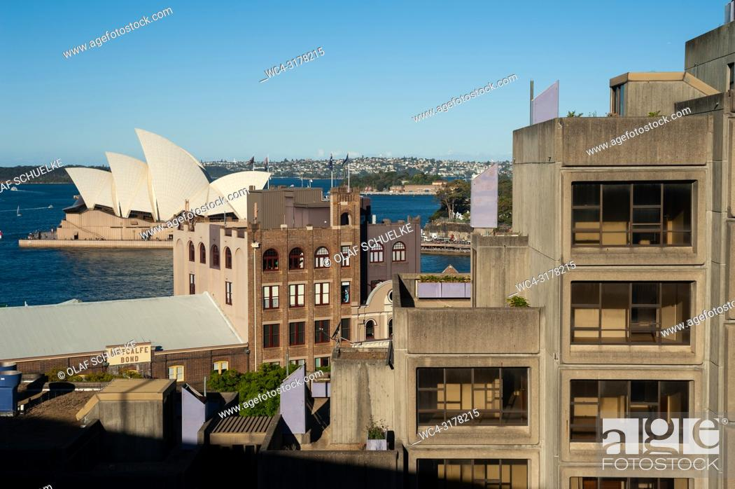 Stock Photo: Sydney, New South Wales, Australia - An elevated view from Sydney Harbour Bridge of buildings in the urban locality of The Rocks and the Sydney Opera House on.