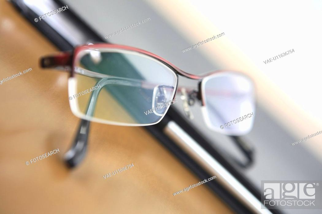 Stock Photo: Notebook and glasses.