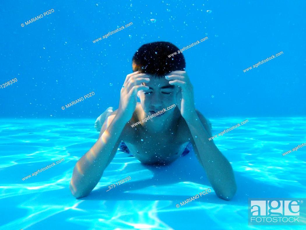 Stock Photo: Pensive boy underwater.