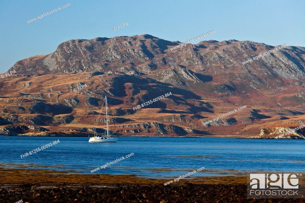 Stock Photo: View of yacht on sea loch, view across to Ruantallan from Tarbert Estate, Loch Tarbert, Isle of Jura, Inner Hebrides, Scotland.