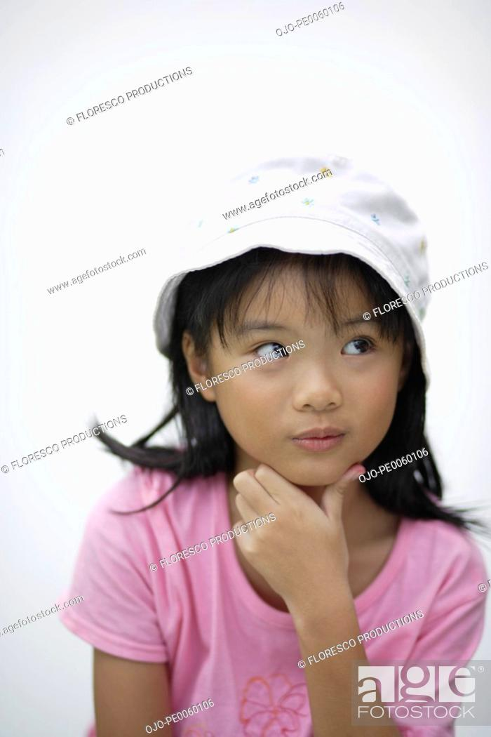Stock Photo: Young girl indoors thinking.