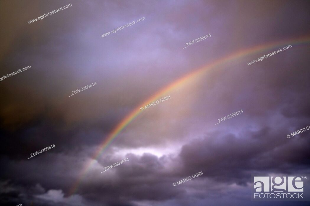 Stock Photo: View of the sky after the storm with the presence of the rainbow.