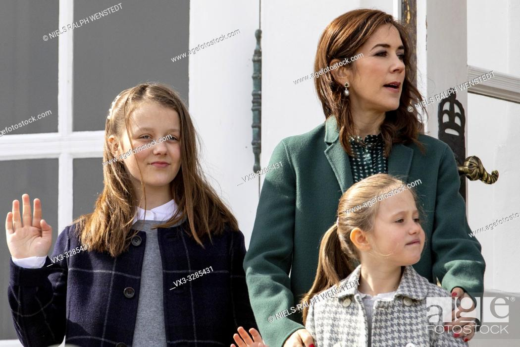 Stock Photo: AARHUS - Queen Margrethe of Denmark, flanked by Crown Prince Frederik, Crown Princess Mary and their children Prince Christian.