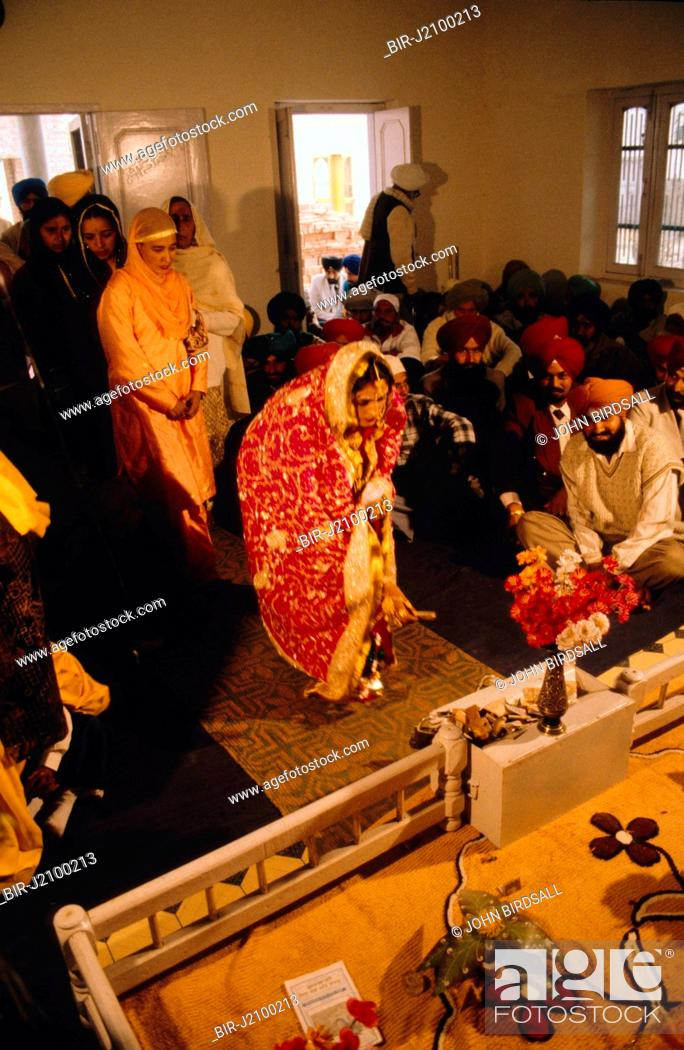 Giving Gifts To The Bride And Groom At Wedding Ceremony In Patiala