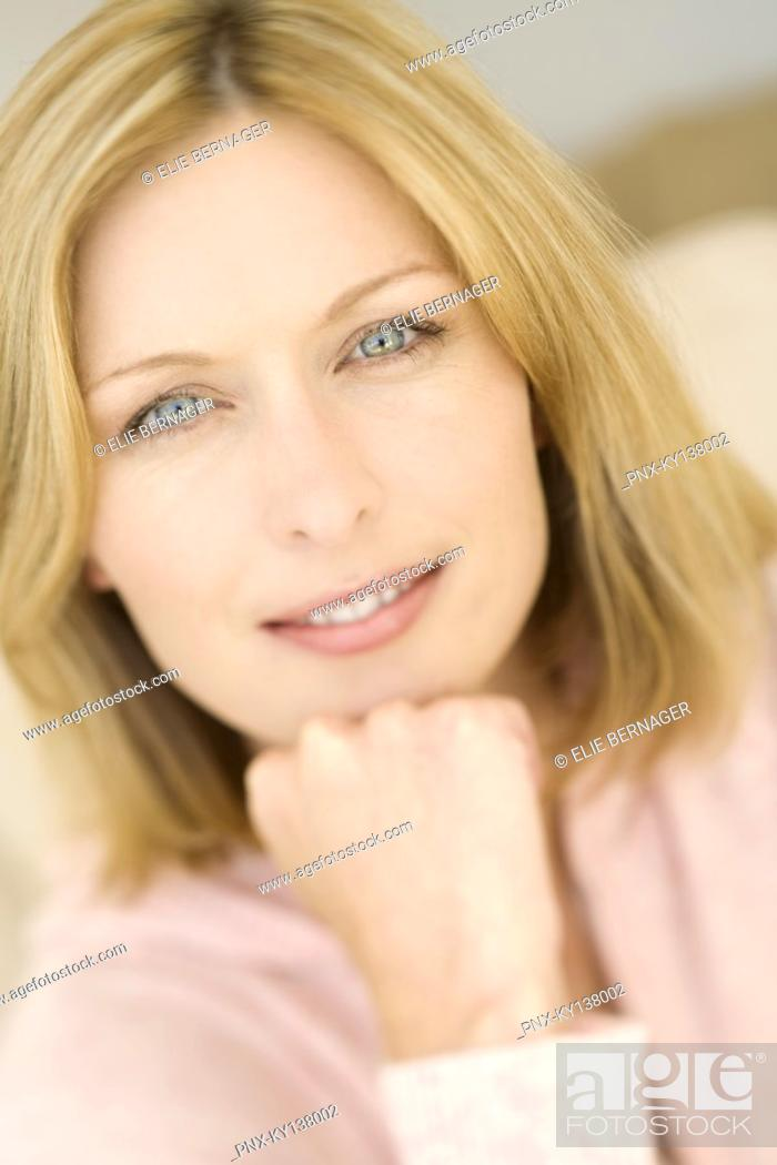 Stock Photo: Portrait of a young woman looking at camera.