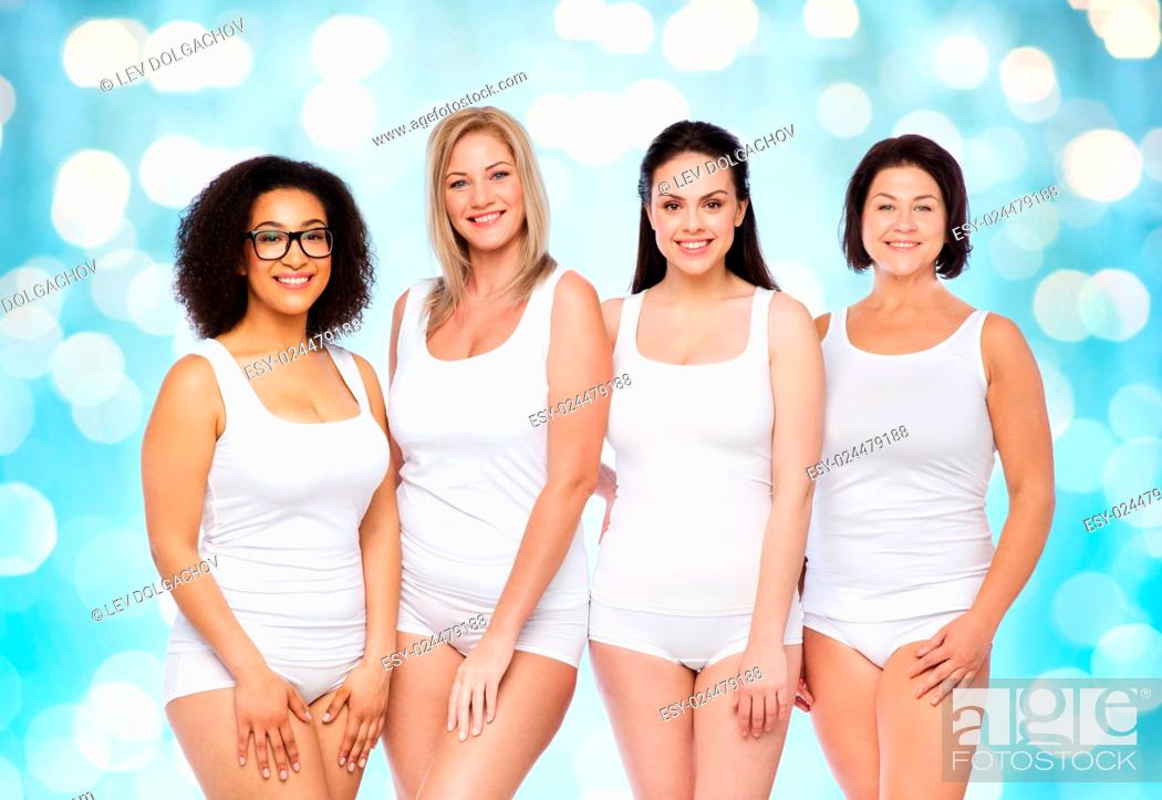 Stock Photo: friendship, beauty, body positive and people concept - group of happy women different in white underwear over blue holidays lights background.