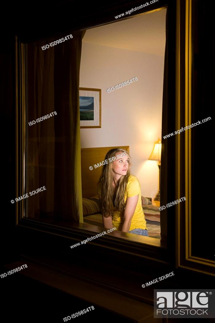 Stock Photo: Young woman in motel room.