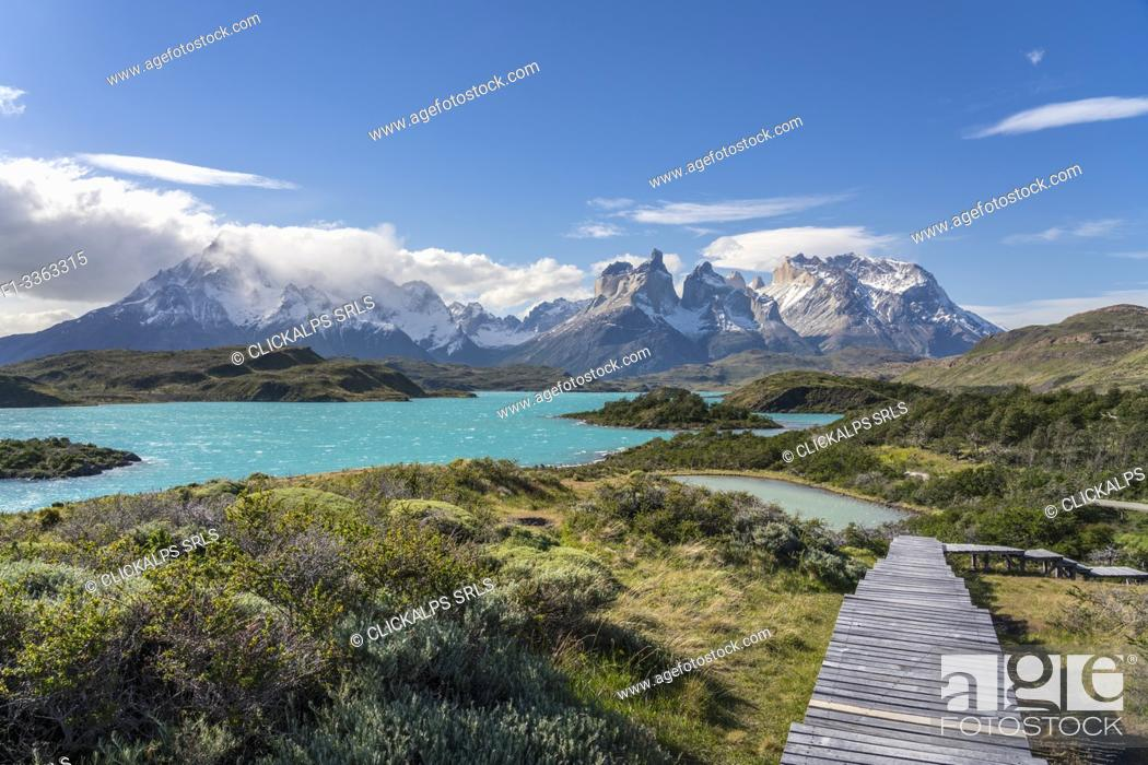 Stock Photo: Boardwalk with Lake Pehoé and Paine Horns in the background, on a windy summer day. Torres del Paine National Park, Ultima Esperanza province, Magallanes region.