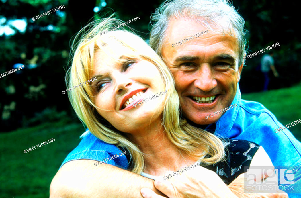 Stock Photo: Portrait of a mature couple holding each other smiling.