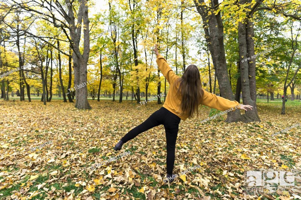 Stock Photo: girl enjoying the autumn in the Prater park, Vienna, Austria.