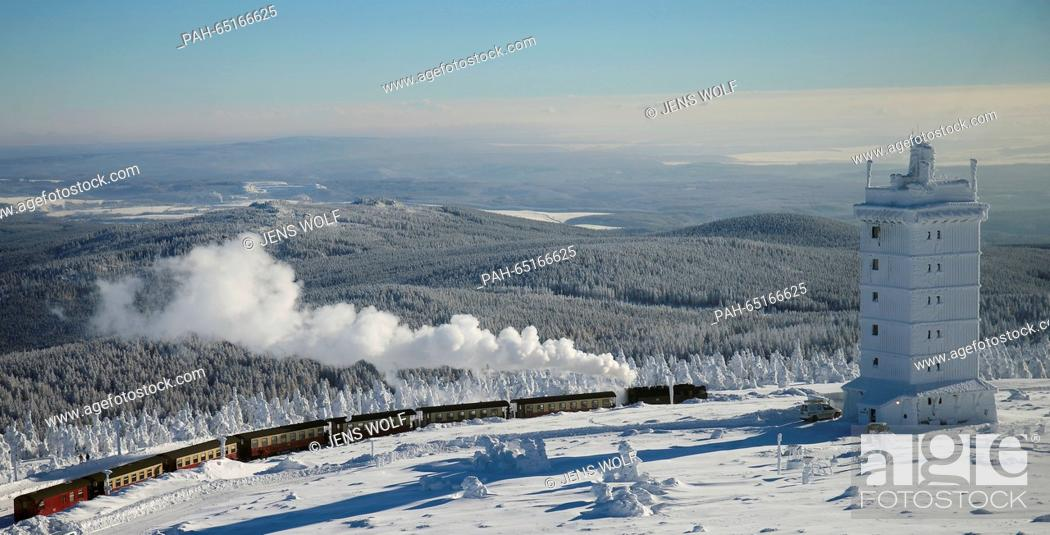 Stock Photo: A steam train of the Harzer Schmalspurbahnen GmbH (HSB, lit. Harz narrow gague railway) travelling from the station on the Brocken mountain back to Wernigerode.