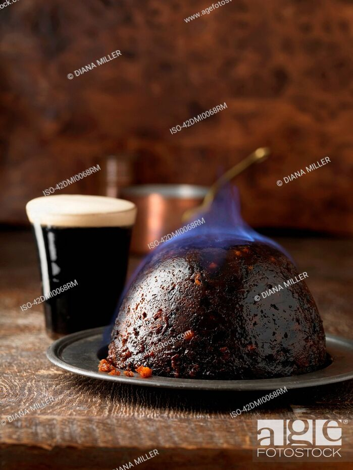 Stock Photo: Flaming Christmas pudding with port.
