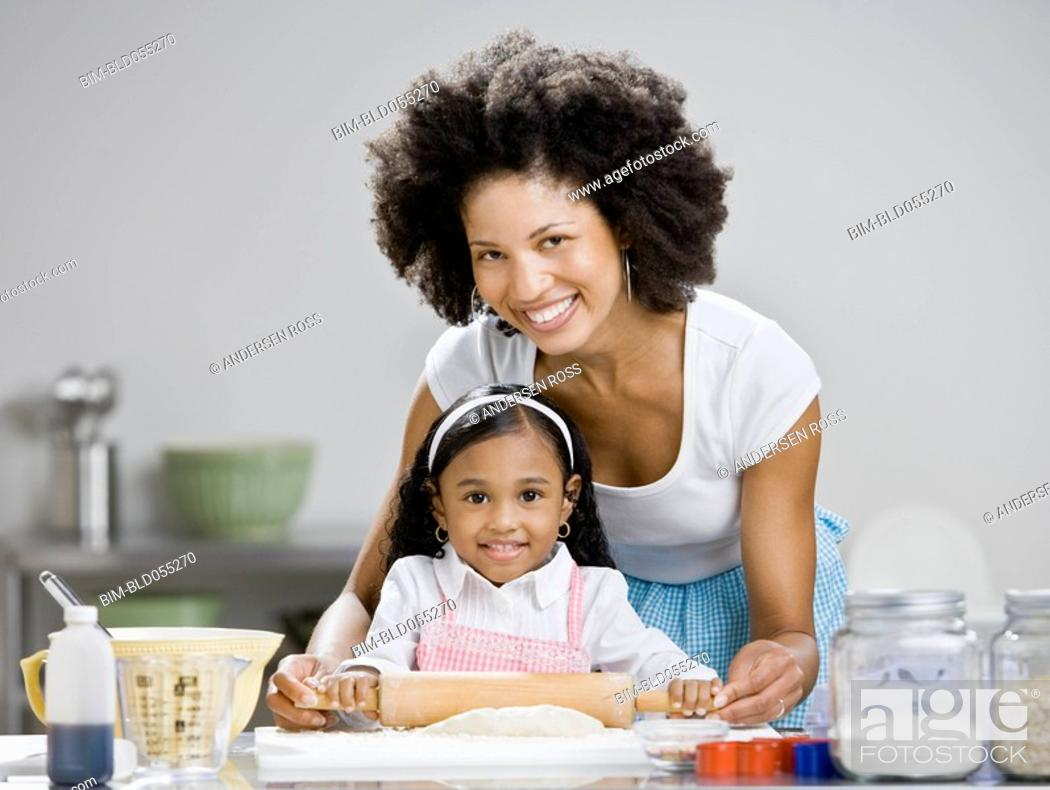 Stock Photo: African mother and daughter baking.